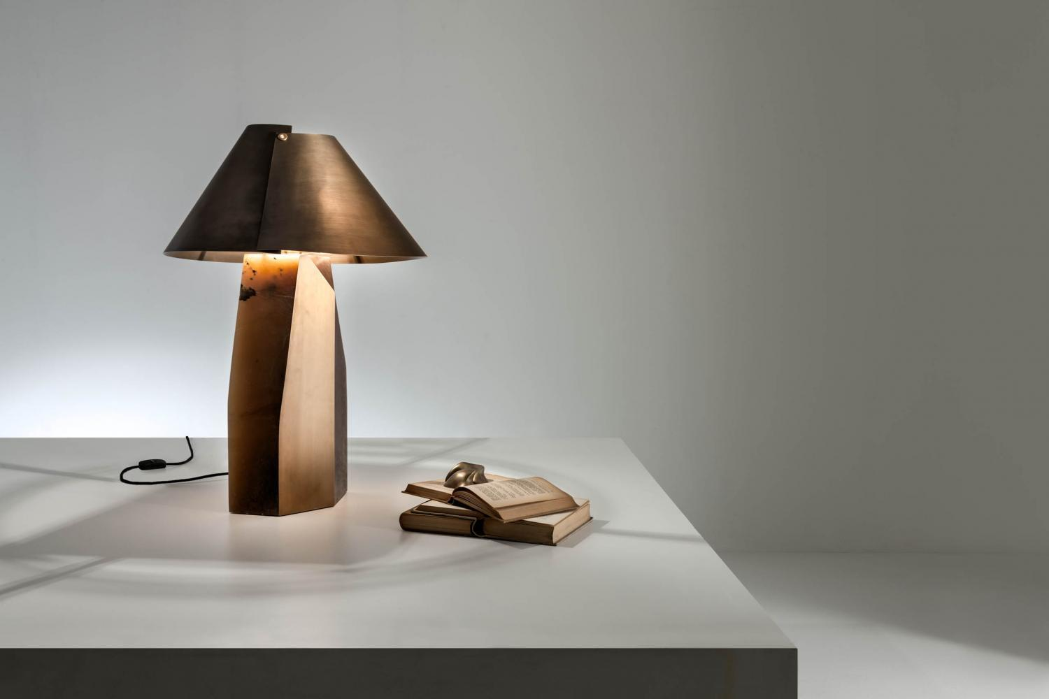 Ada is a table lamp with Alabaster base and brass lampshade.