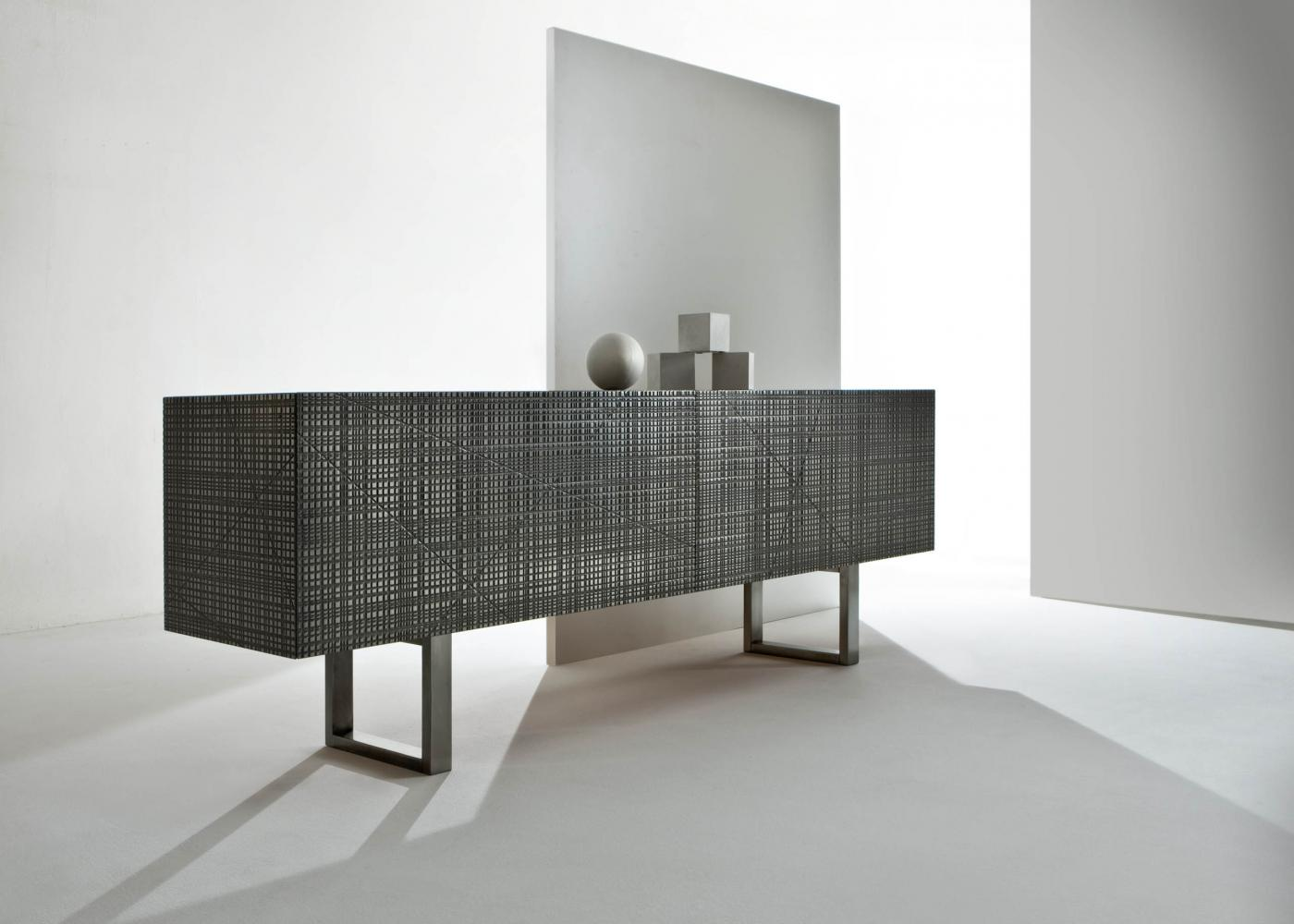 BD 91 is a Low sideboard with Maxima surface in tin liquid metal finish