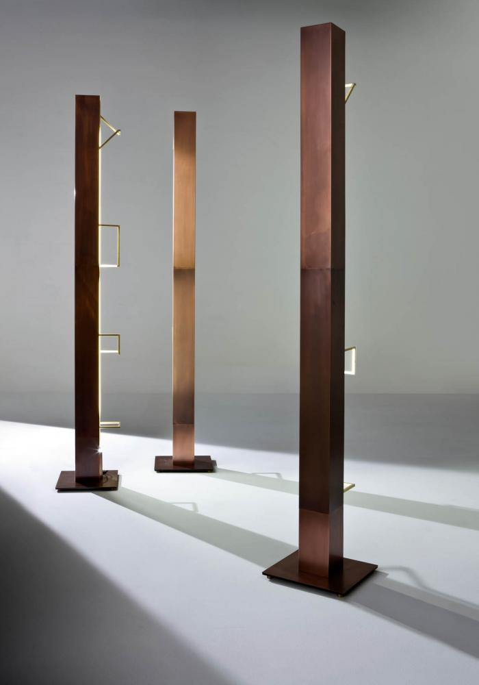 Modern floor lamp with burnished copper structure