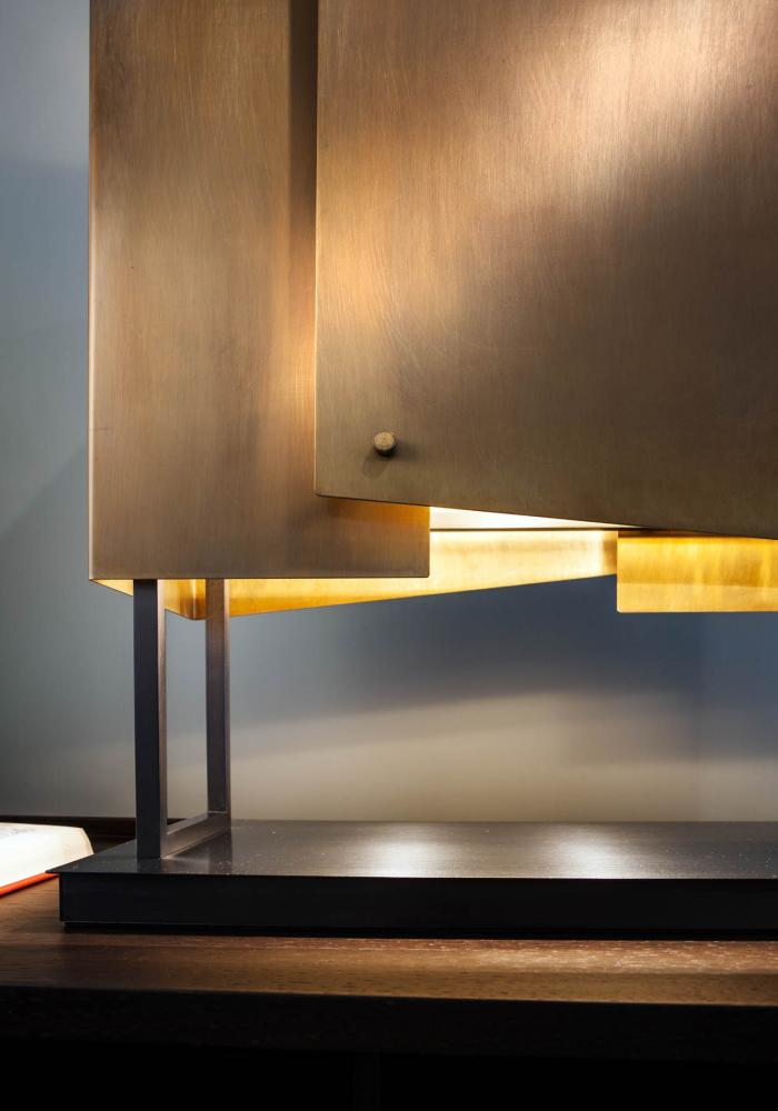 Table lamp with black nickel and burnished brass structure