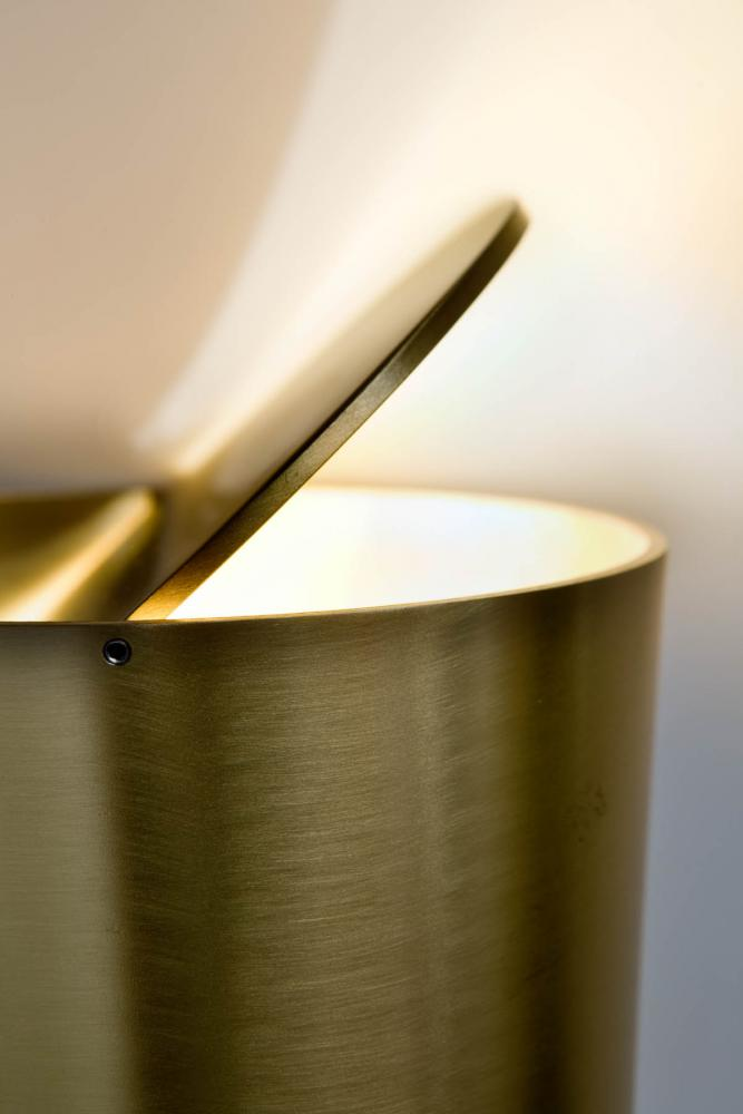 Modern table lamp with satin brass tubular structure