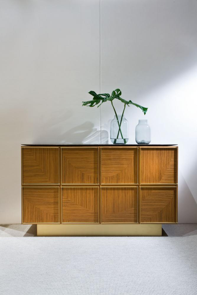 Modular luxury storage unit with brass frame and teak wood structure composed as sideboard