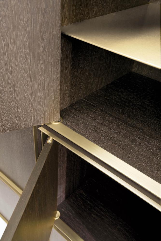 Modular luxury storage unit with brass frame dark wood structure composed as sideboard