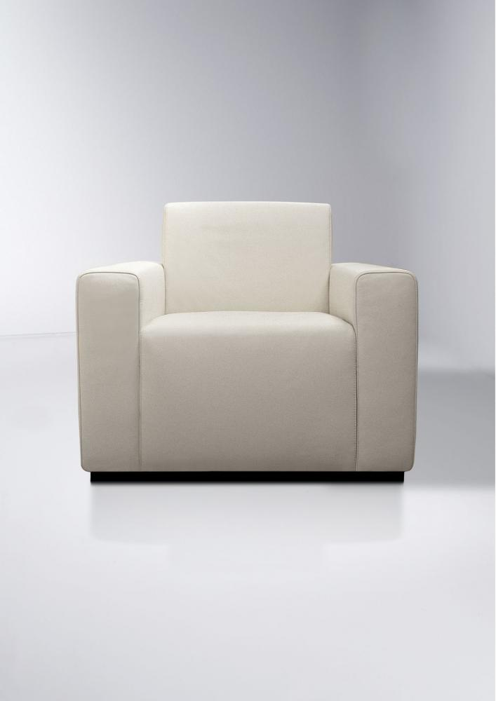 Comfortable and elegant armchair covered with leather or fabric