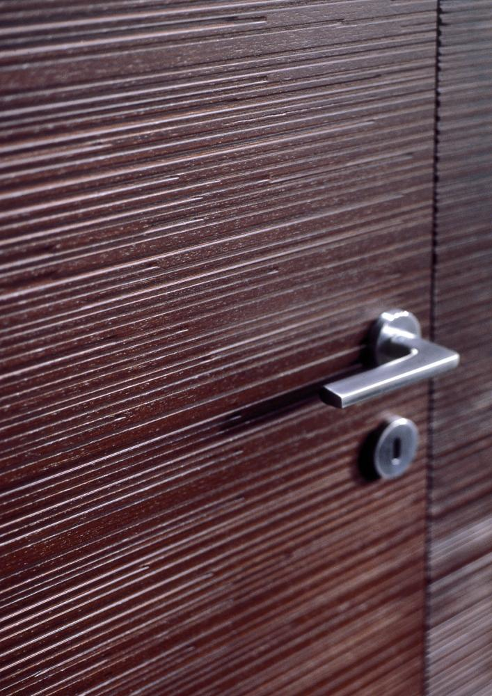 Custom made hinged door with Decor carved wood texture