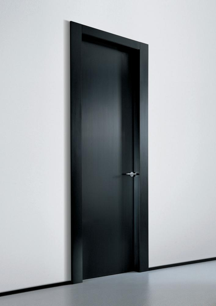 Custom made black lacquered hinged door in wood