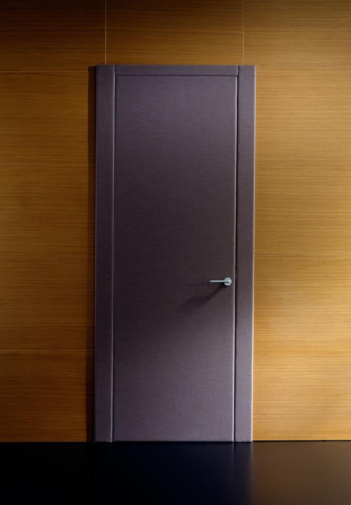 Custom made fabric padded hinged door in wood