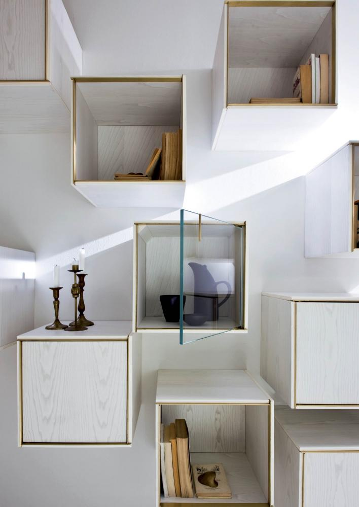 Modular luxury storage unit with brass frame white wood structure and glass doors