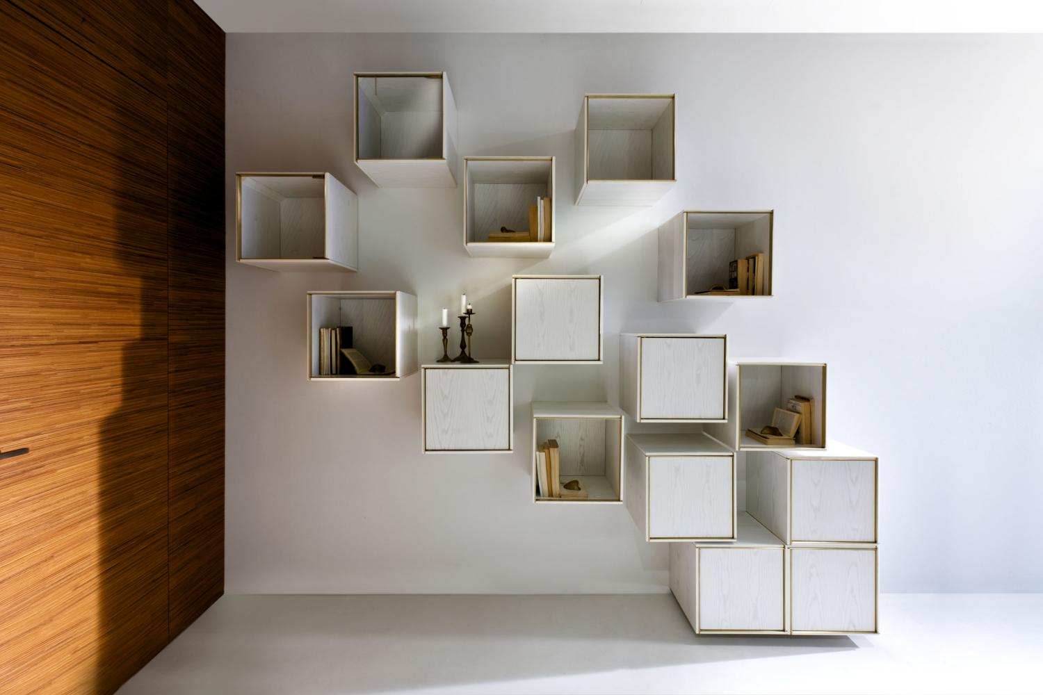 Modular luxury storage unit with brass frame and white wood structure