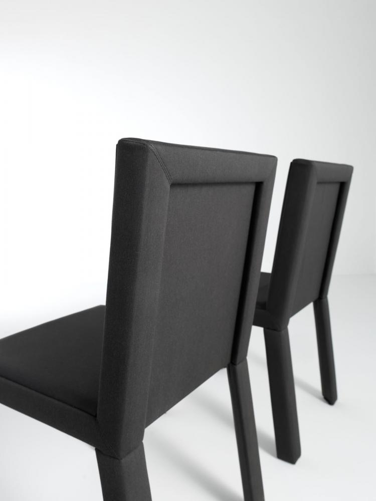 Modern chair with wooden structure covered with fabric or leather