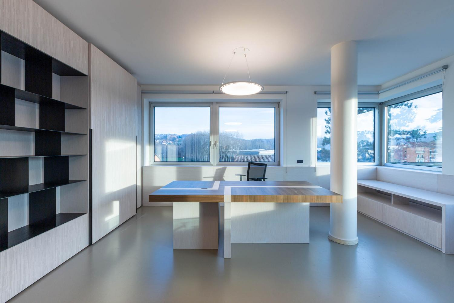 Laurameroni corporate office interior design wooden inlaid wall panels and rectangular table for a luxury modern furnishing
