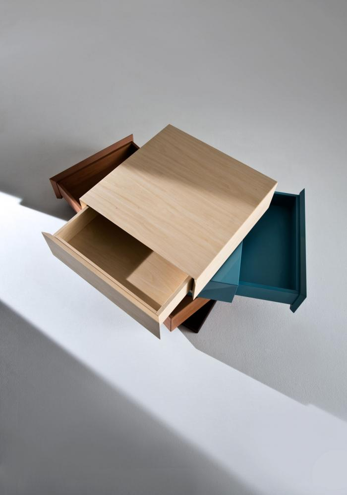 Rotating modular chest of drawers in wood with customizable finishes