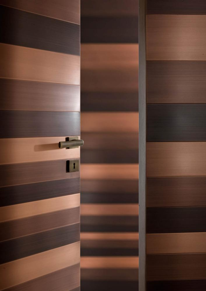 laurameroni burnished copper wall panels and door detail