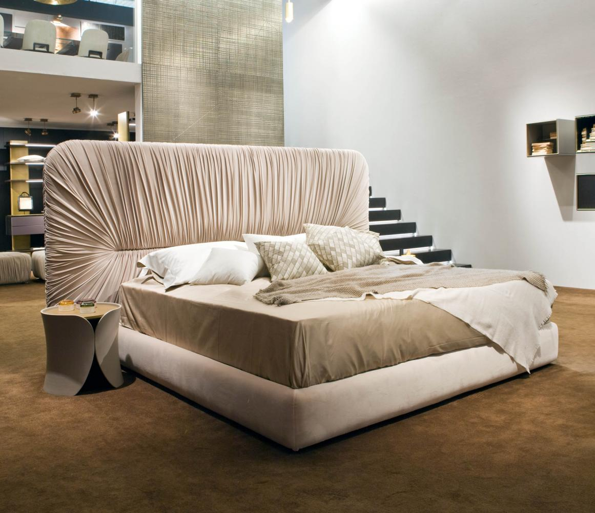 laurameroni custom luxury wooden box-spring base bed with draped headboard in velvet or leather