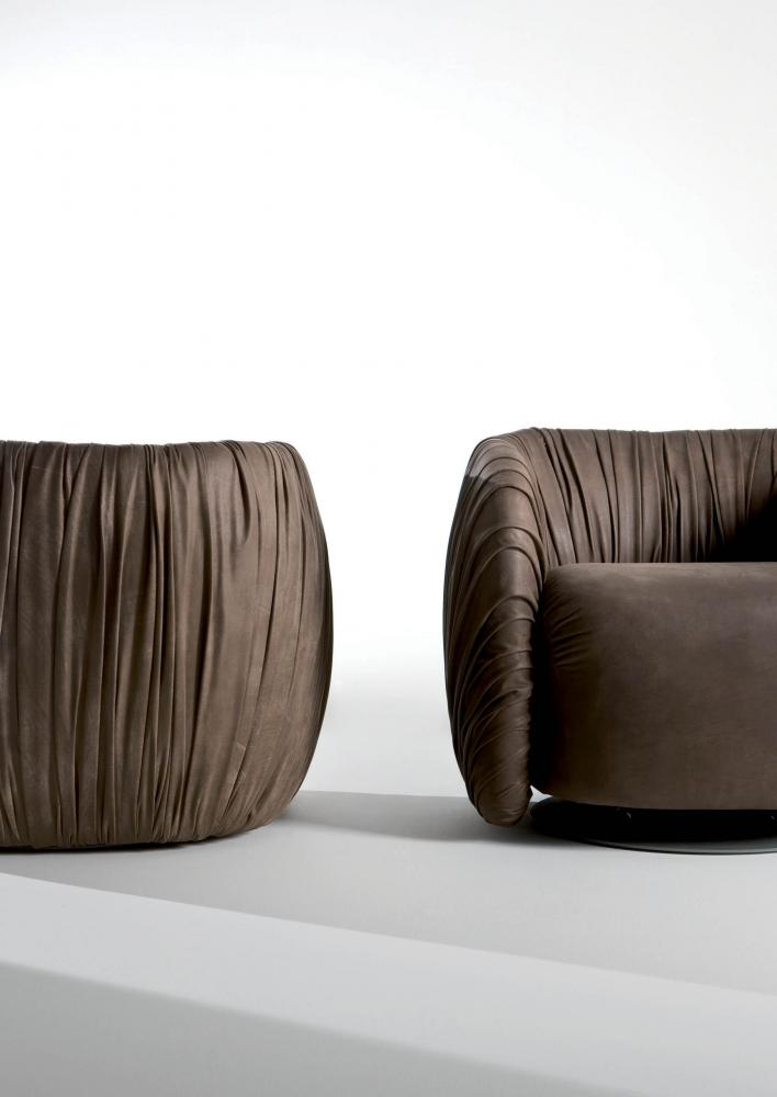 Drapè Lounge is a leather or velvet luxuxy swivel armchair with pleats