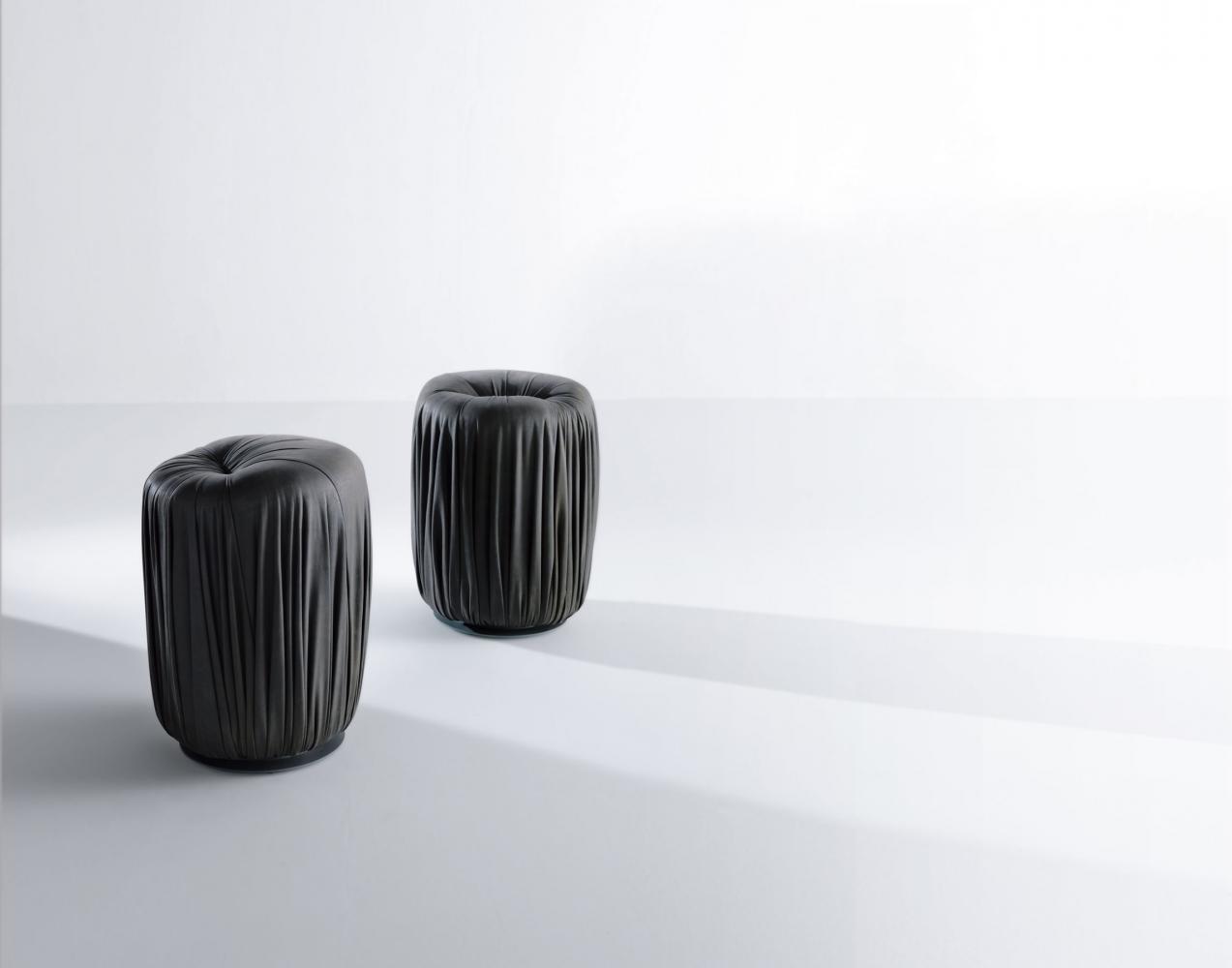 Drapè Poufs are leather or velvet luxury ottomans with pleats