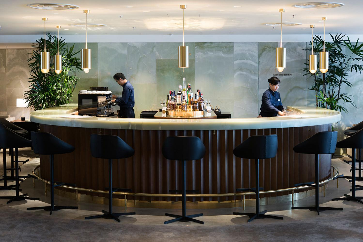 laurameroni hand made in italy satin brass suspension lamp featured at cathay pacific first class lounge the pier
