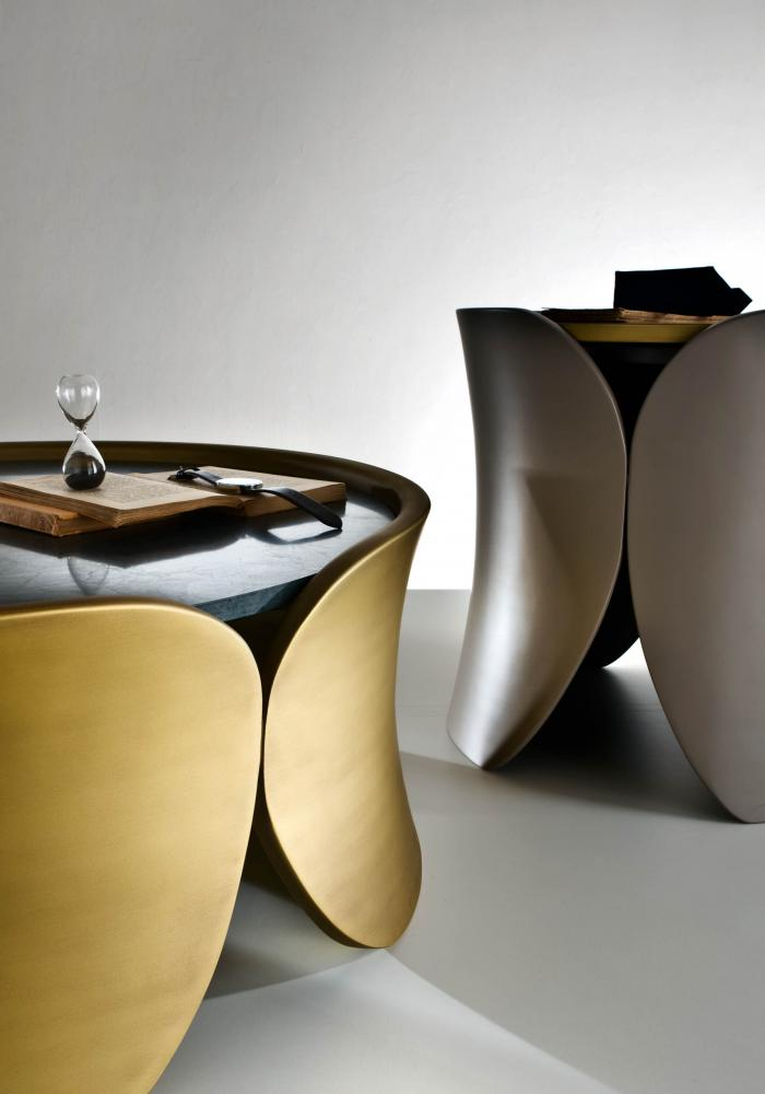 detail of laurameroni hugs low tables in brass colour lacquered wood with marble top