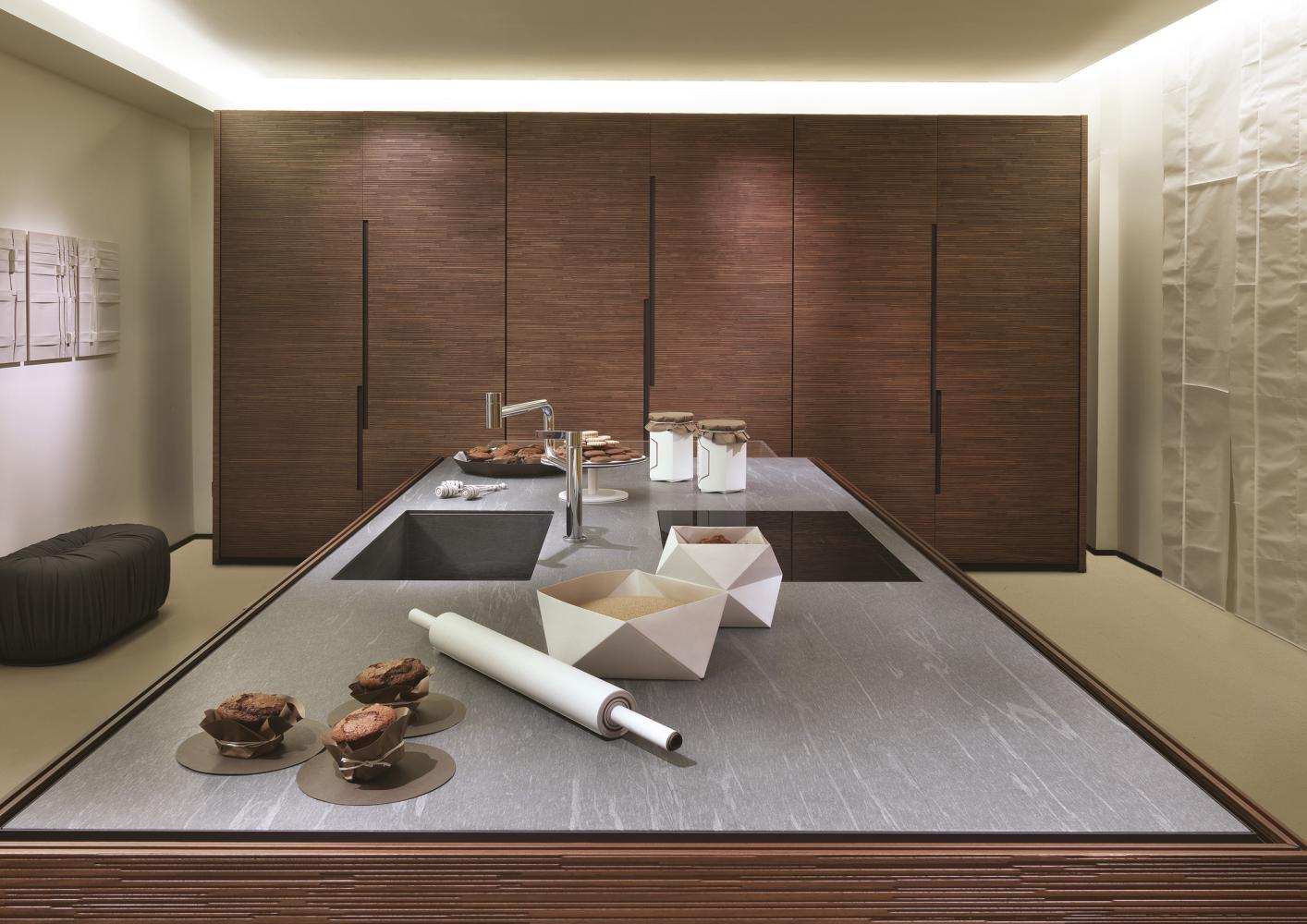 Bespoke luxury modern kitchen in carved wood with cardoso marble top