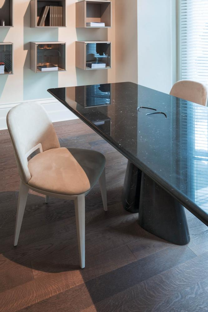 raja marble table in black marquinia and margaret chair in nubuk leather