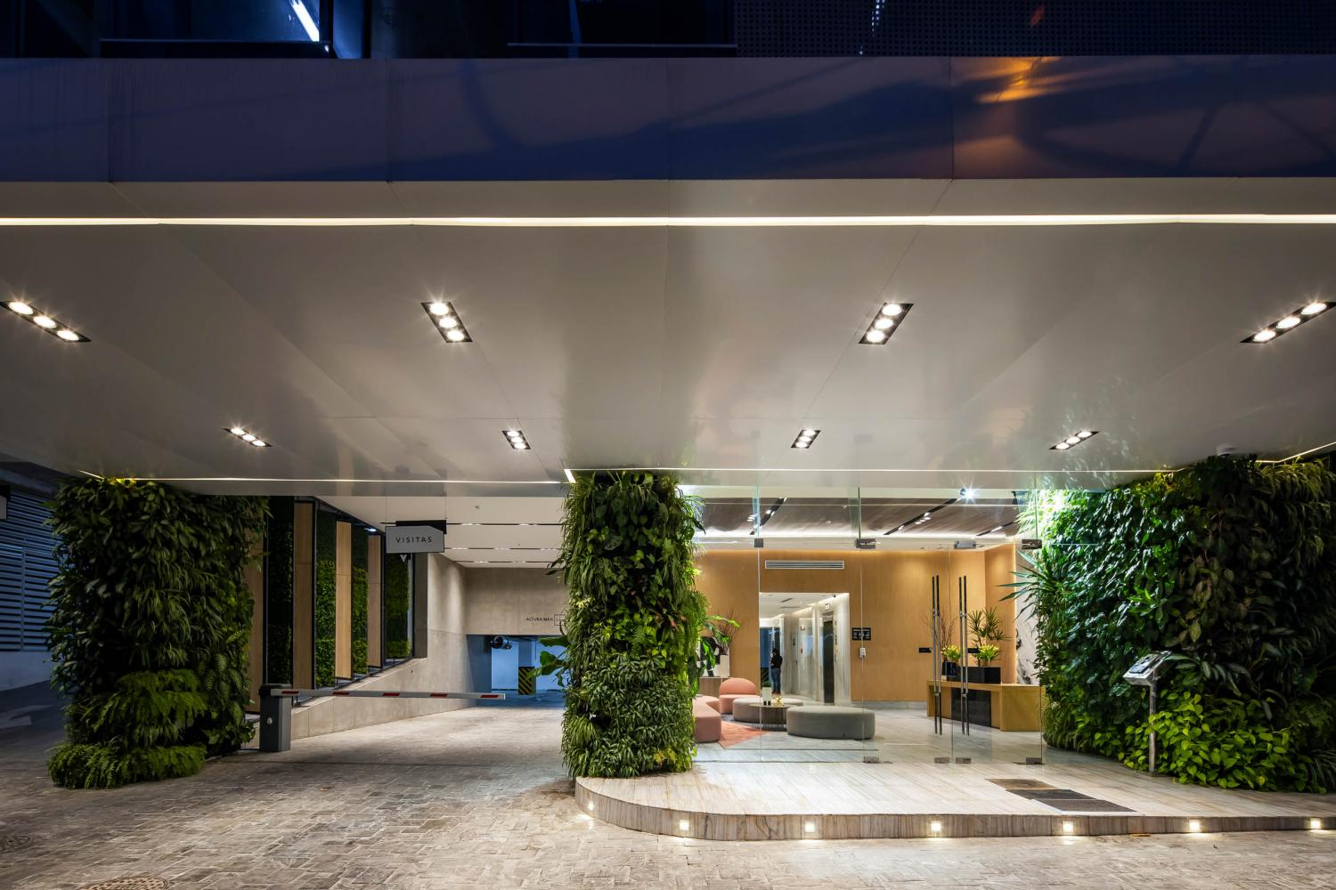 Laurameroni furnishing a luxury entrance hall of the Velure Tower in Panama, a modern interior decor with oak wood carved wall panels