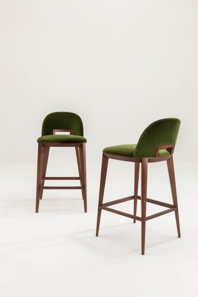 modern bar stool with 4 legs wood structure upholstered in green velvet