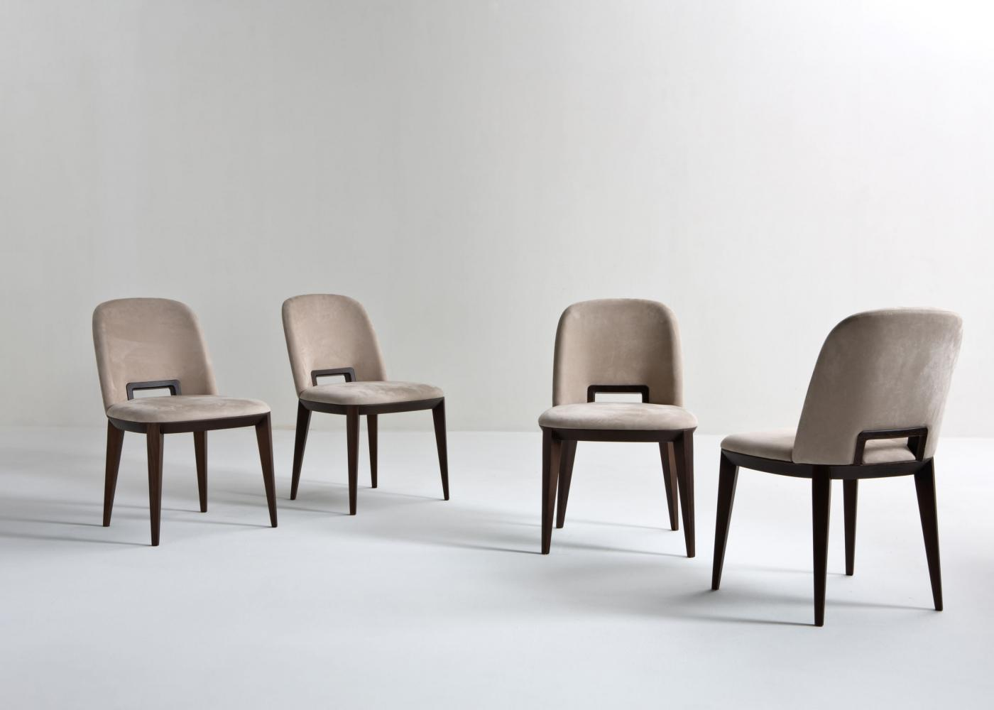 Modern chair in leather velvet or fabric with wooden handle