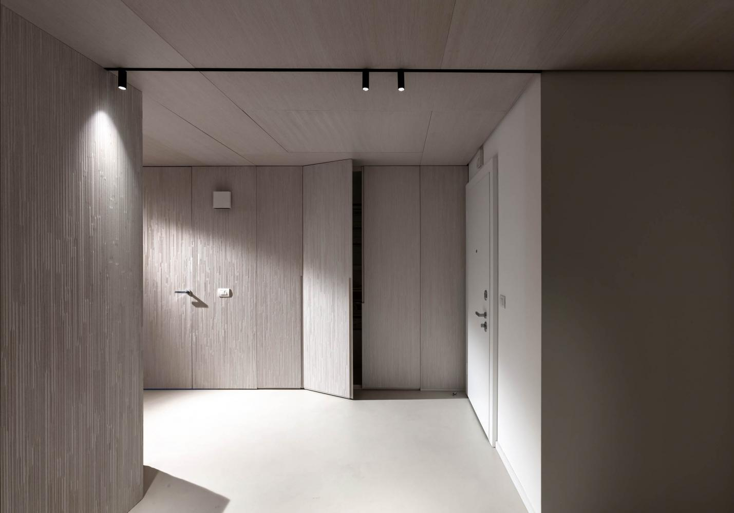 laurameroni luxury and elegant corporate modern design entrance with integrated cabinets and panels aniline white dyed