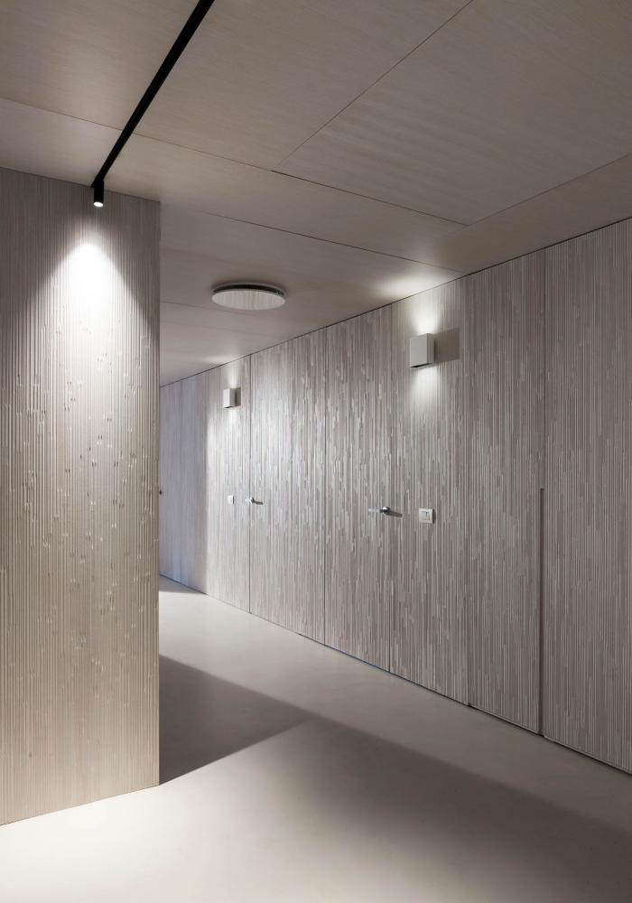 laurameroni luxury and elegant corporate modern design office corridor with integrated cabinets and panels aniline white dyed
