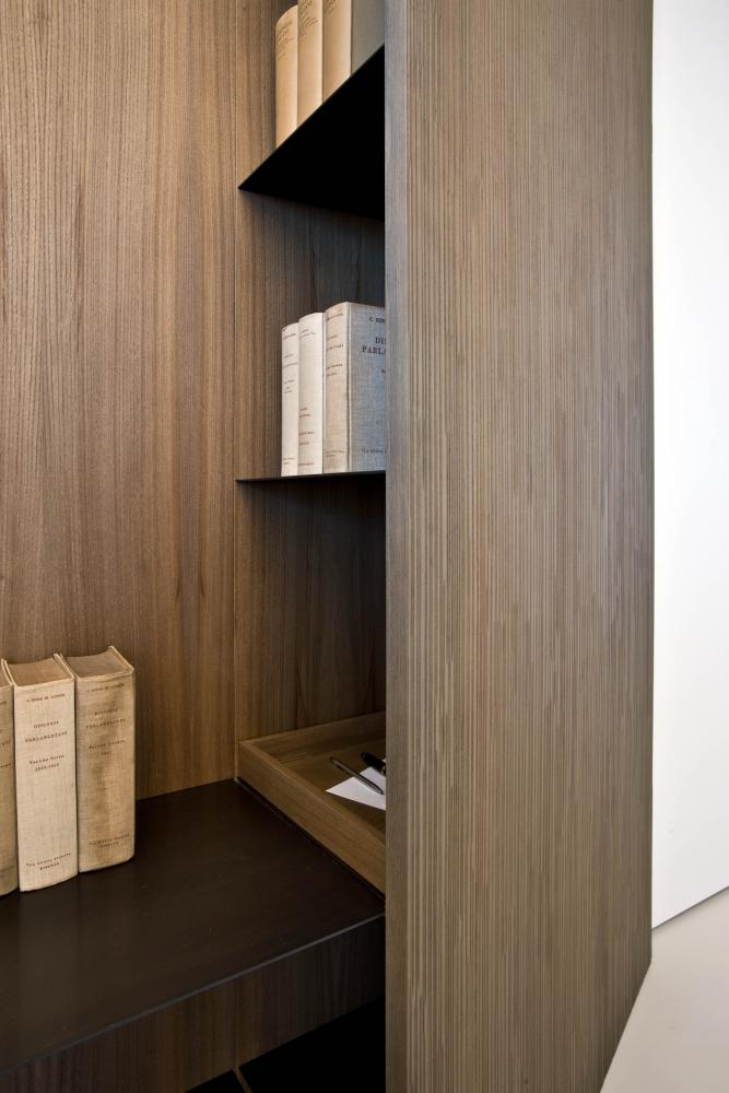 laurameroni detail of luxury custom book case with metal shelves for ceo office in elm wood