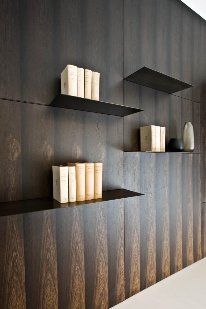 laurameroni detail of luxury custom made wall panels and shelves in metal for conference room in stone oak wood hand made in italy