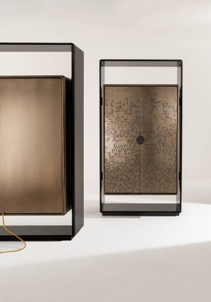 tall unit cabinet with black laquered structure and bronze liquid metal doors
