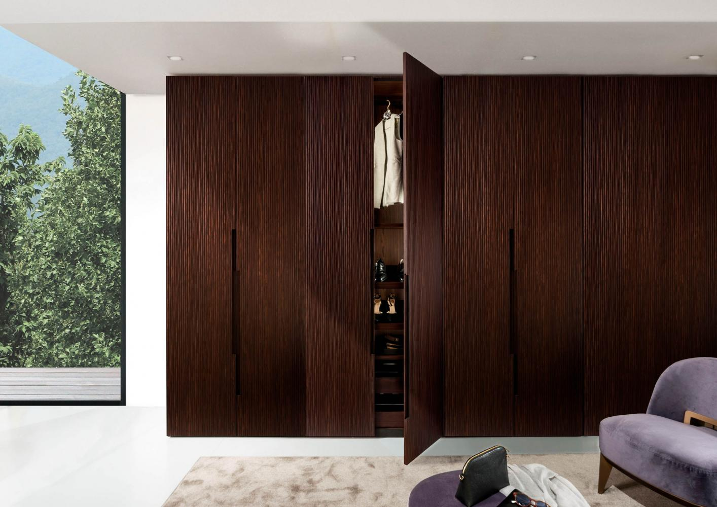 custom made wardrobes in wood with onda carved hinged doors