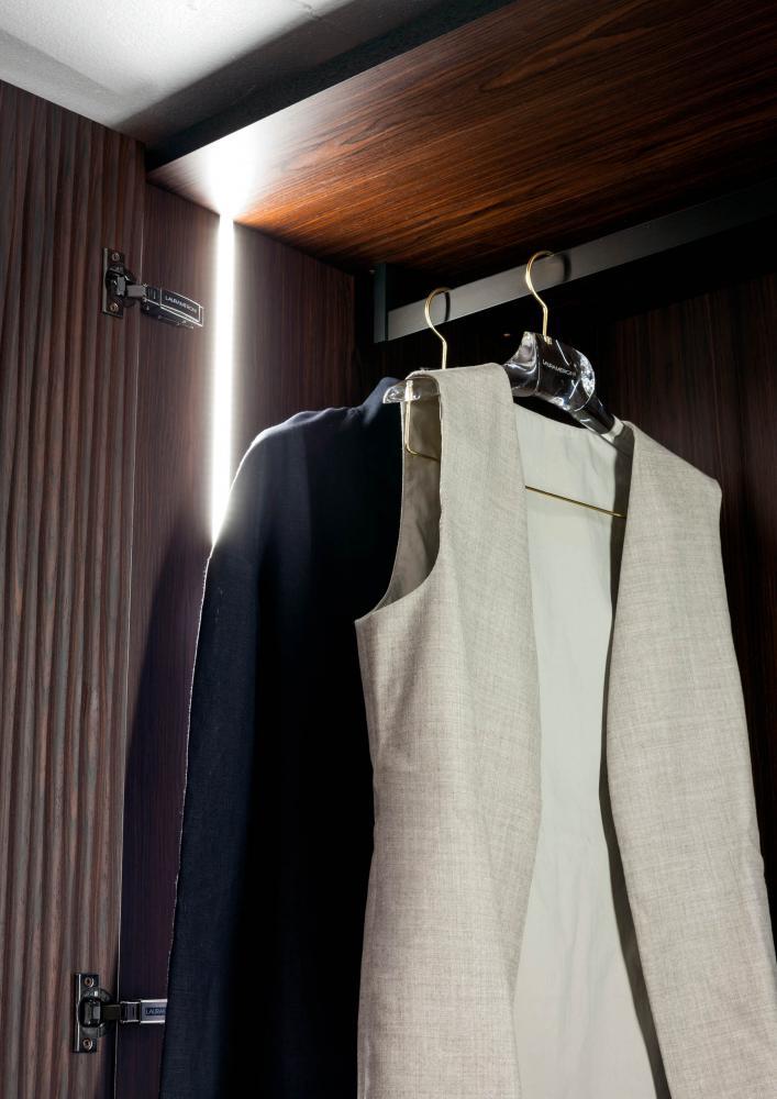 custom made wardrobes in wood with black metal coat hanger