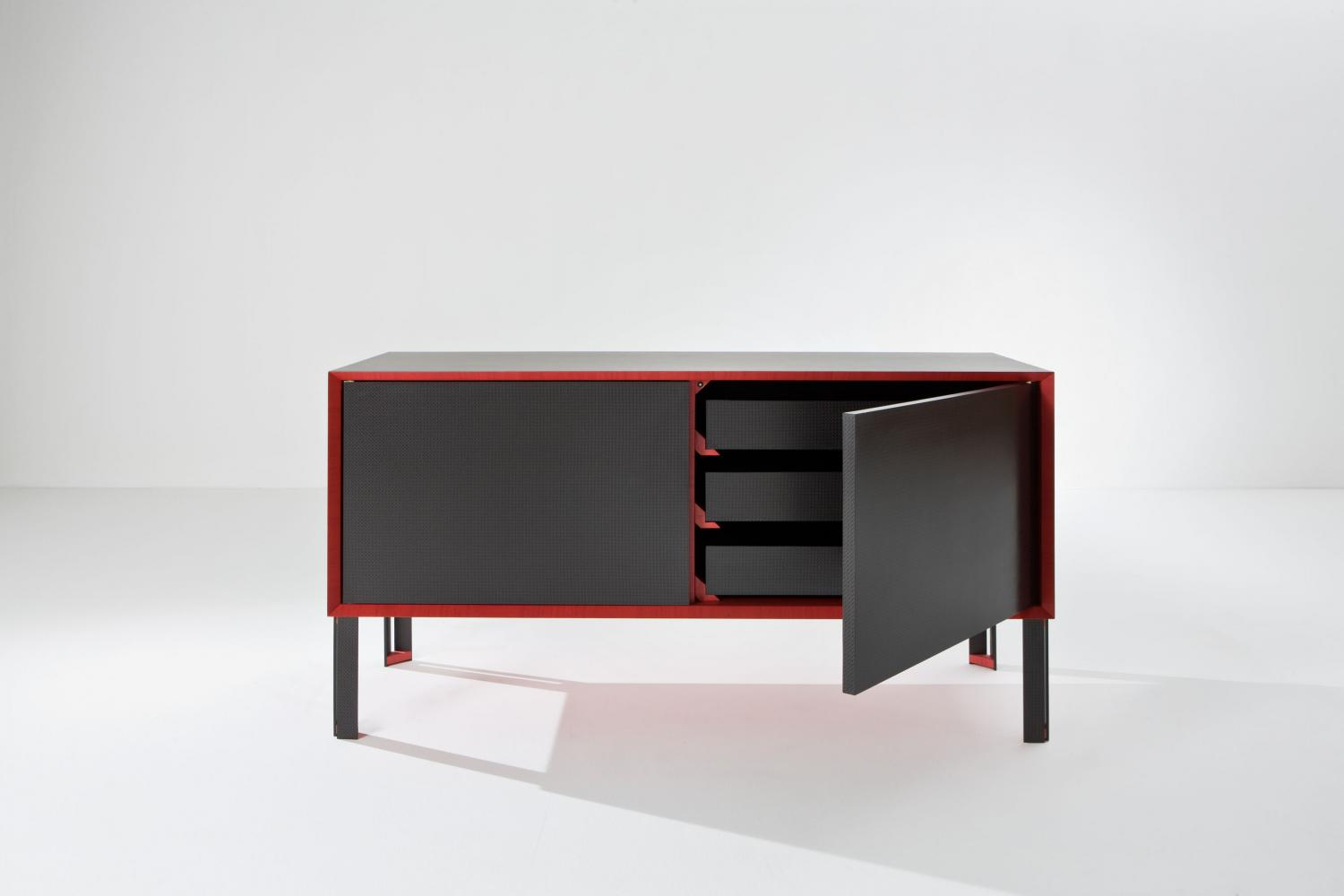 Luxury sideboard designed by Fabrizio Giugiaro handmade in Italy in carbon fiber and StoneOak wood with red frame.