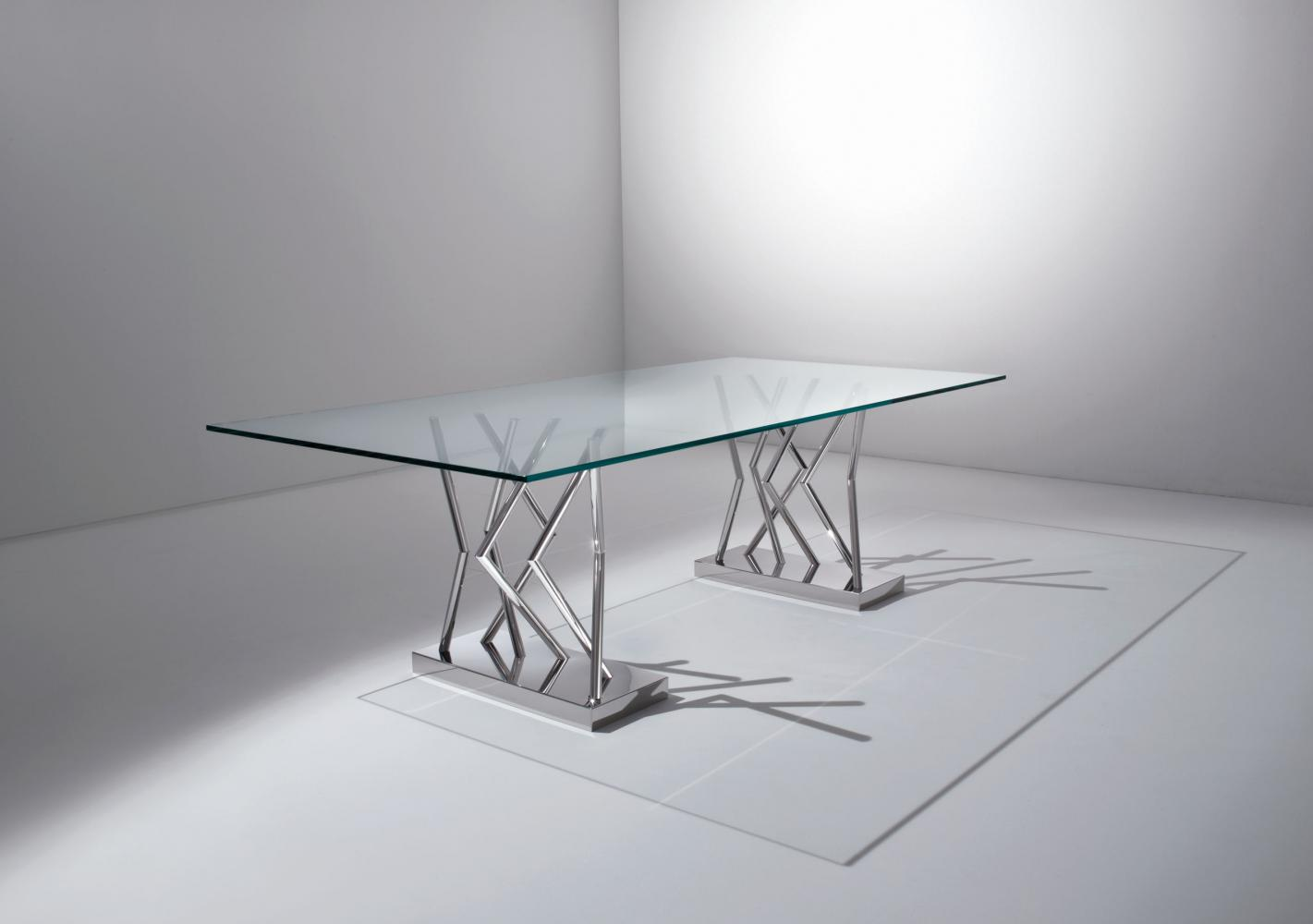 Modern glass and steel table designed by Sottsass Associati