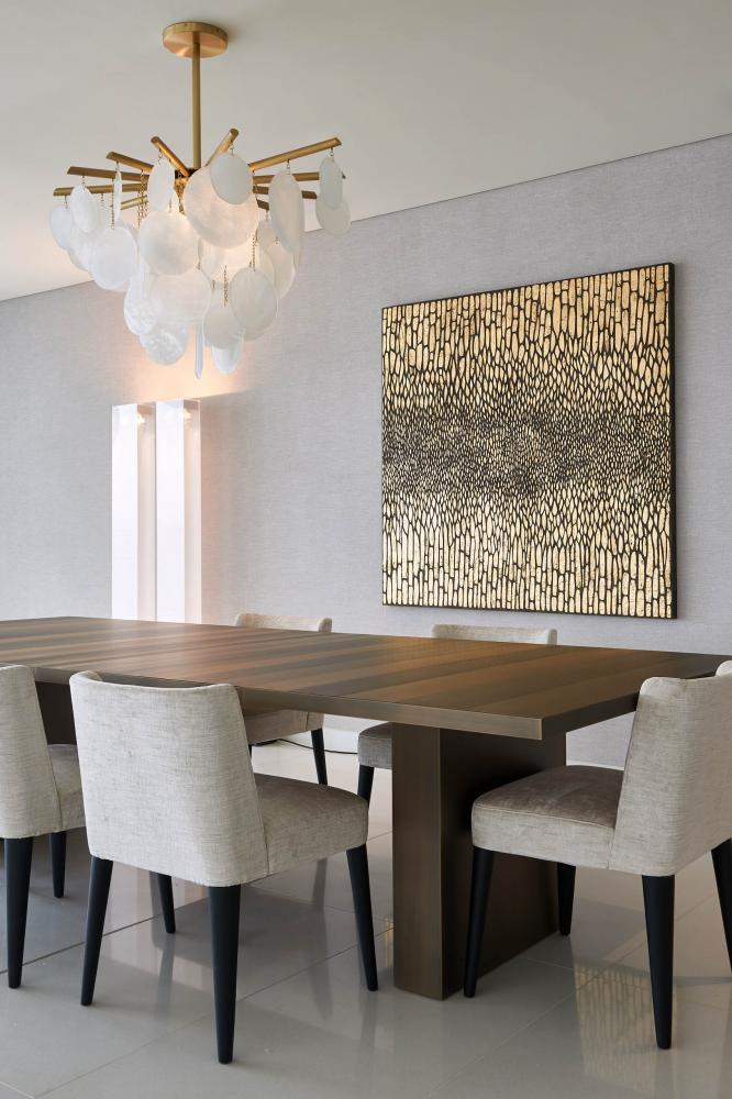 Luxury modern table clad in metal for dining room Laurameroni in Dubai Serenia Residences by Caspaiou Interior Design