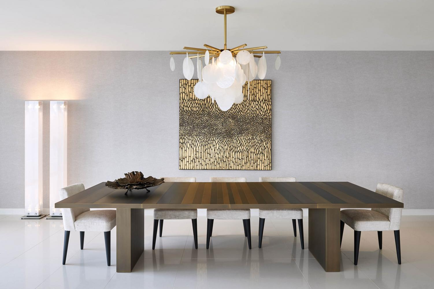 Luxury modern table clad in metal for dining room Laurameroni in Dubai Serenia Residences by Caspaiou Interior Design