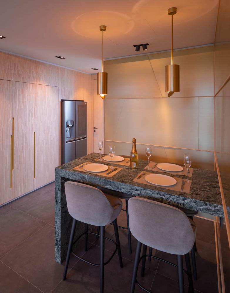 brass lamps and brass wall panels with marble kitchen table