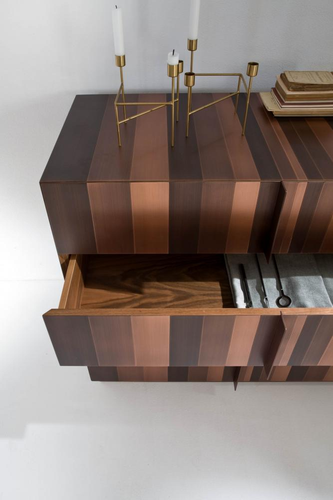 modern design luxury chest of drawers entirely cladded in copper metal inside finished in walnut wood