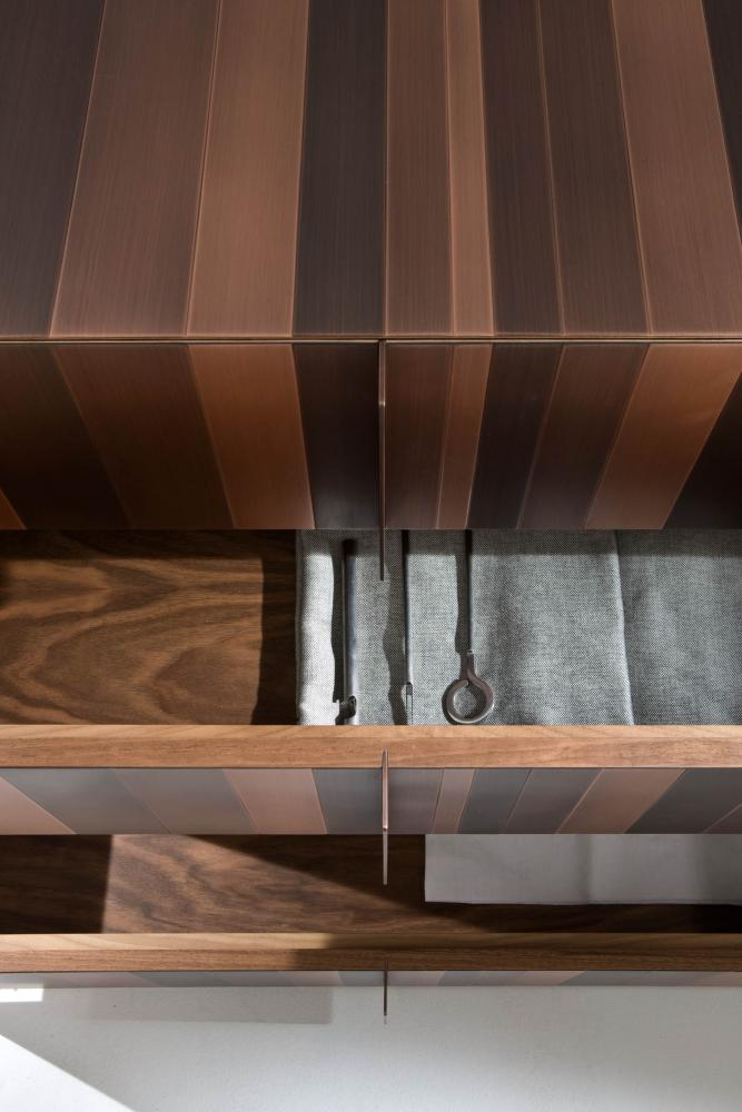 modern design luxury chest of drawers entirely cladded in copper metal