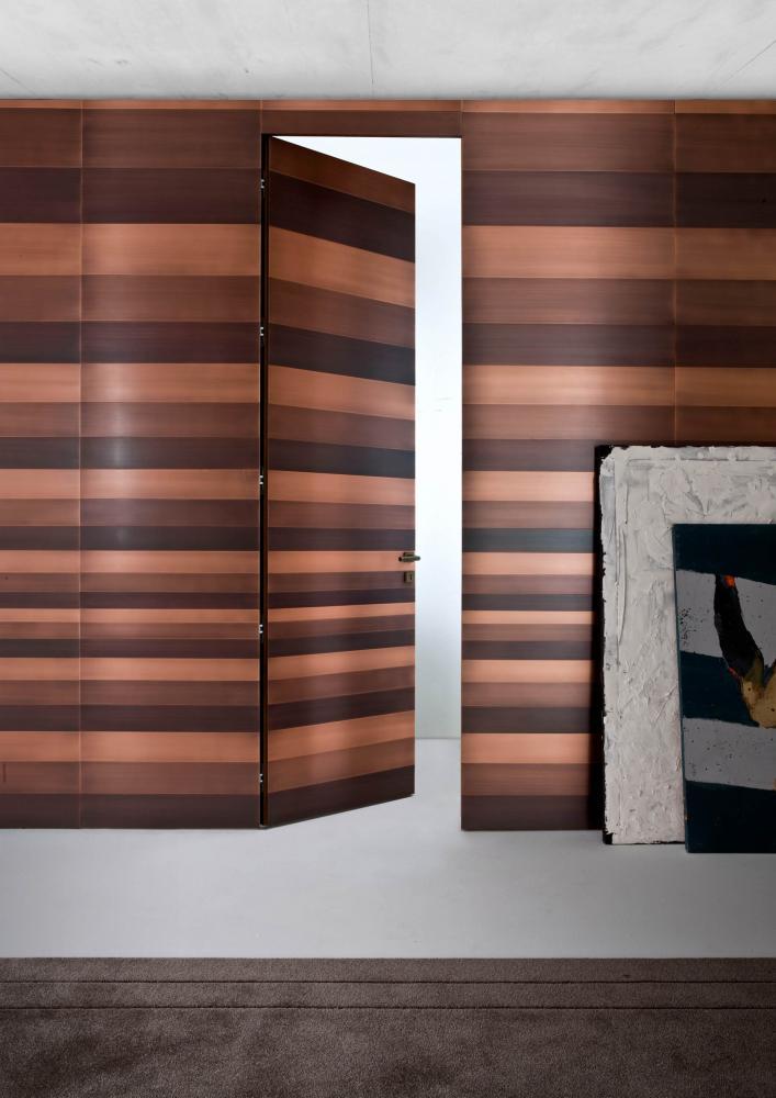 Stars custom made luxury wardrobe in wood with metal clad hinged doors