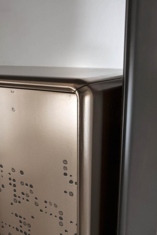 Talento detail of round smooth edge of cabinet with liquid metal structure