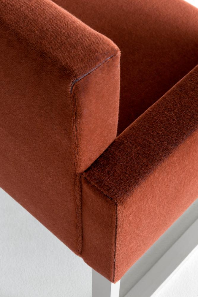 Modern padded chair in leather fabric or velvet