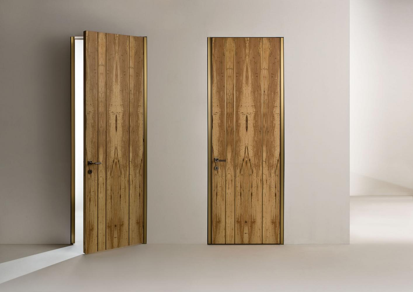 Line Hinged Door is a Custom made luxury hinged door with brass finish profiles
