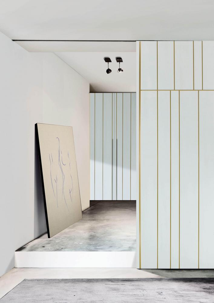 custom made wardrobes in wood with hinged doors decorated by a metal channel profile