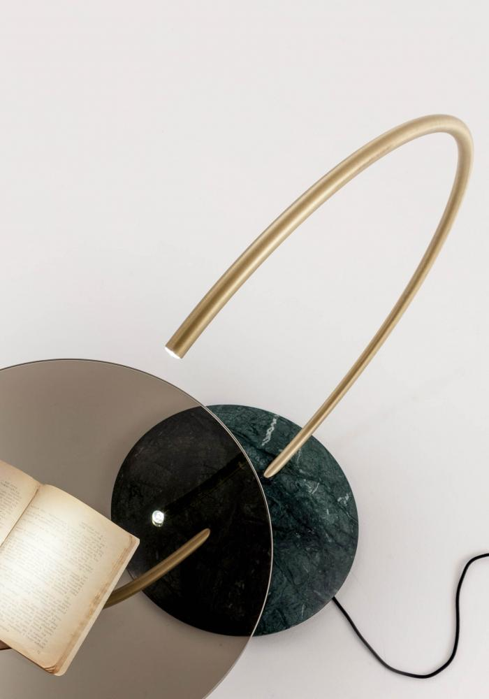 Carl is a Modern circular side table in mable and brass