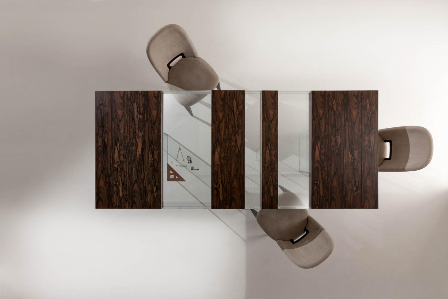 Elemento is a luxury modular rectangular table in marble or wood and glass