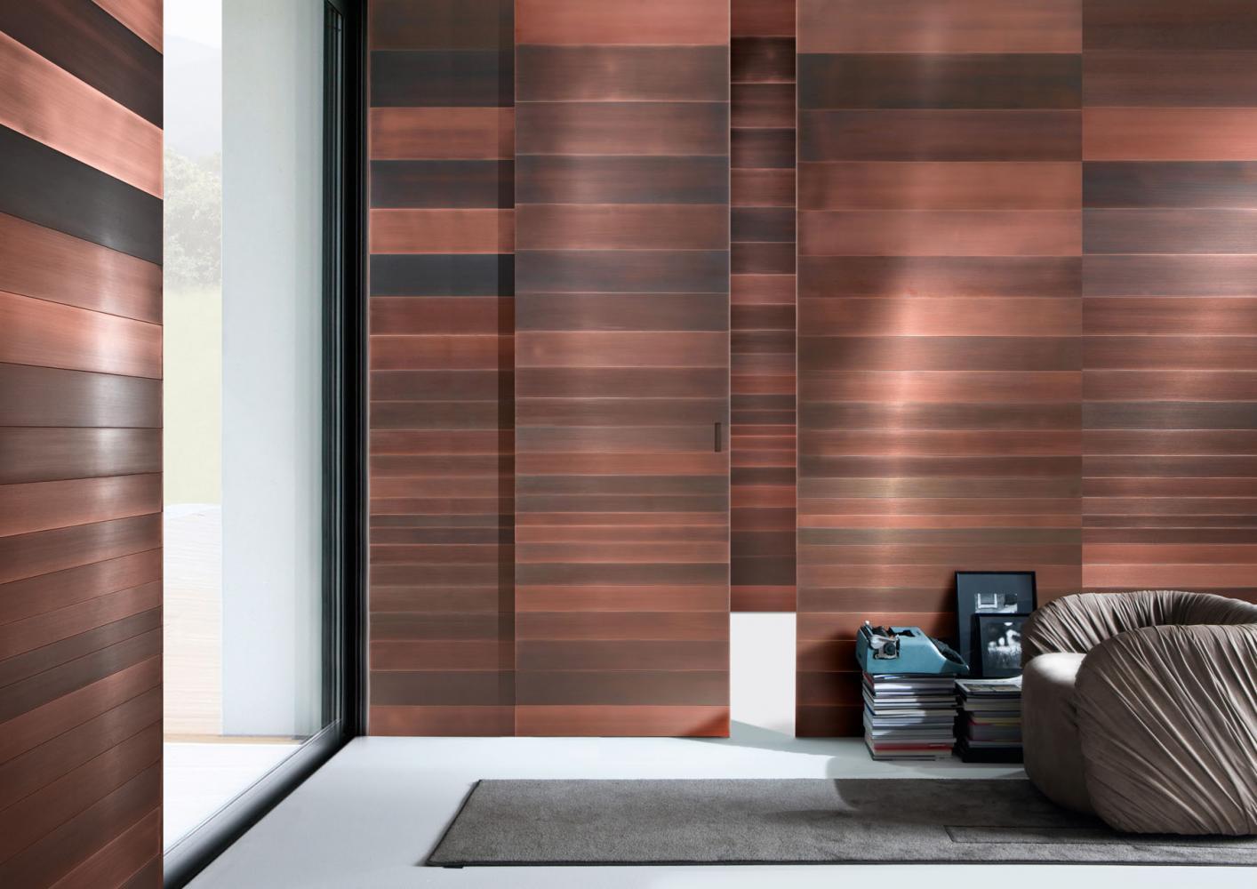 Stars Sliding Door is a custom made metal clad sliding doors in brass, copper or iron