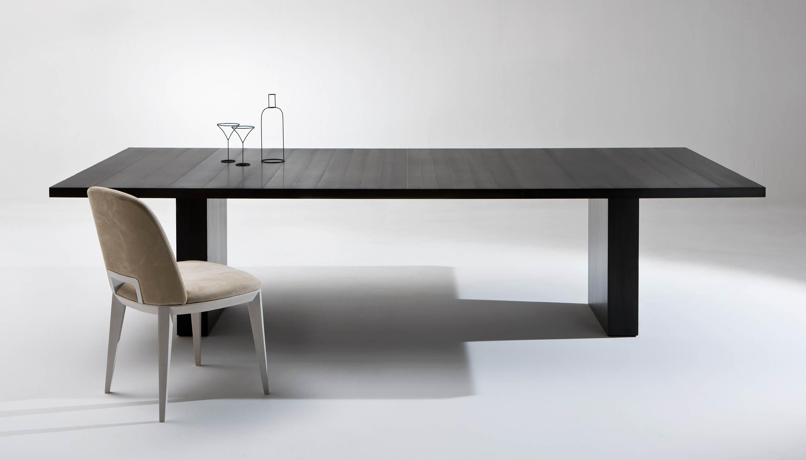Black metal clad table surface design for luxury minimal interiors